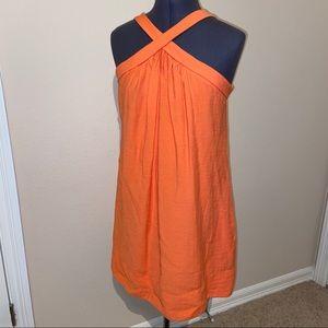 Orange short dress with criss-cross detail